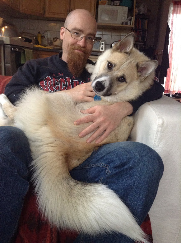 Corbin and Von snuggling. This Akita/Husky cross is very cuddly